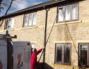 Window cleaning a house